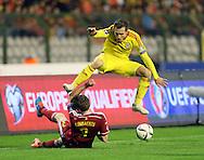 Belgium's Nicolas Lombaerts tussles with Wales' Aaron Ramsey<br /> <br /> - European Qualifier - Belgium vs Wales- Heysel Stadium - Brussels - Belgium - 16th November 2014  - Picture David Klein/Sportimage