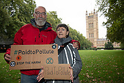 Paid to Pollute claimants Kairin van Sweeden and Jeremy Cox outside Victoria Tower Gardens South on 2nd October 2021 in London, United Kingdom. Kairin and Jeremy are two of the three climate activists taking the UK government to court over the billions of pounds of public money it spends supporting the oil and gas industry, as part of the Paid to Pollute campaign. <br /> <br /> Jeremy Cox is a retired former oil worker, current Extinction Rebellion activist, beekeeper, green woodworker and amateur baker.<br /> <br /> Kairin van Sweeden is an SNP Common Weal organiser for the North east of Scotland, the daughter of an oil worker, an Aberdeen quine and Executive Director of the Modern Money Scotland think tank.