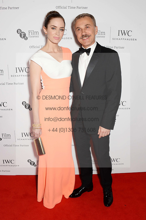 EMILY BLUNT and CHRISTOPH WALTZ at the IWC Schaffhausen Gala Dinner in honour of the British Film Institute held at the Battersea Evolution, Battersea Park, London on 7th October 2014.