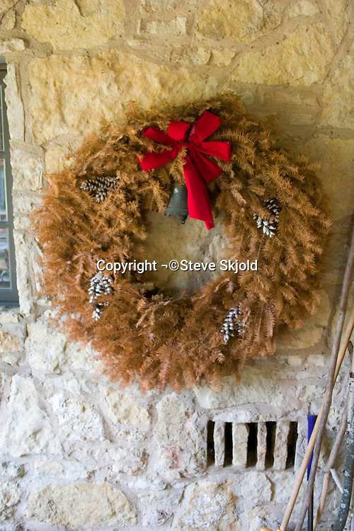 Beautiful dried up Christmas wreath forgotten on hunting lodge wall. Concept - Retired.  Blue River Wisconsin USA
