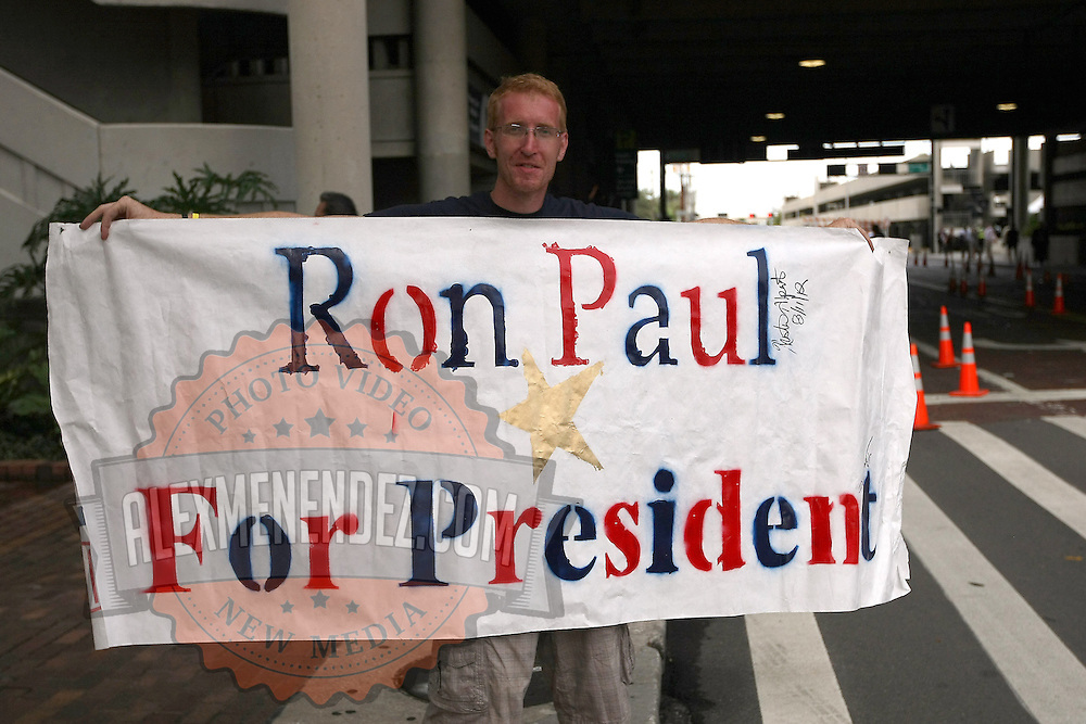 A Ron Paul supporter holds up a sign outside of a downtown parking garage during the Republican National Convention in Tampa, Fla. on Wednesday, August 29, 2012. (AP Photo/Alex Menendez)
