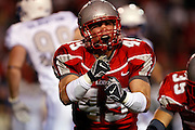 Steven St. John/Tribune..UNM linebacker Zack Arnett reacts after making a tackle on special teams. UNM defeated Air Force 34-31 Thursday night at University Stadium.