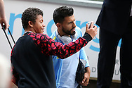 Sergio Aguero of Manchester city poses for a photo with a fan as he arrives at the stadium ahead of the game. Premier league match, Swansea city v Manchester city at the Liberty Stadium in Swansea, South Wales on Saturday 24th September 2016.<br /> pic by Andrew Orchard, Andrew Orchard sports photography.