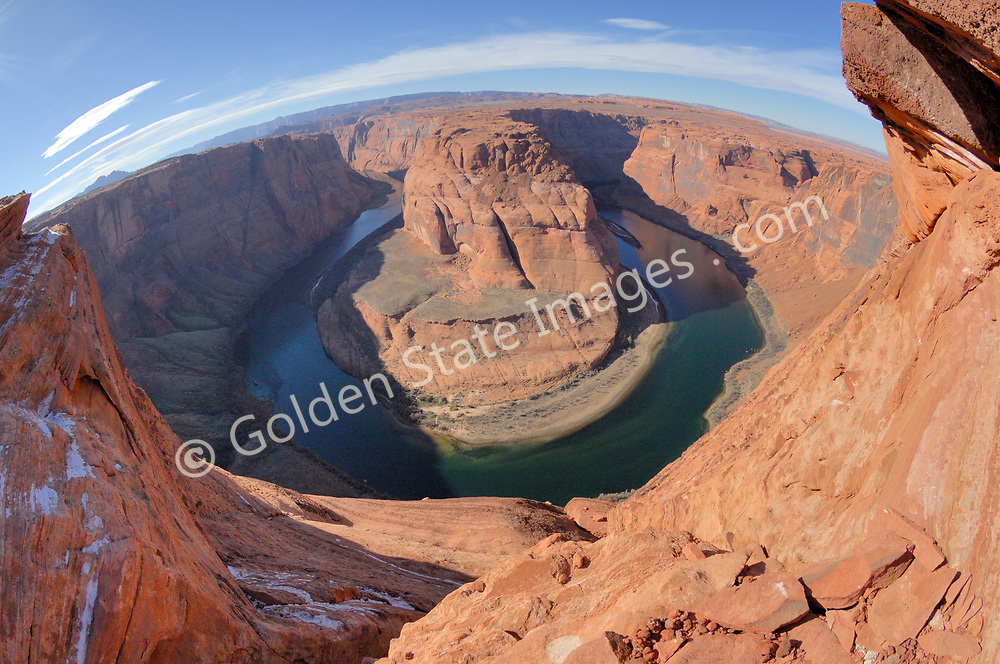 The perspective of this image is distorted due to the use of a fisheye lens.<br /> <br /> Outside the town of Page Arizona and downstream of Glenn Canyon Dam on Lake Powell the Colorado River makes this dramatic bend.
