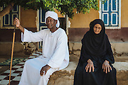 """Hajj Elias and his wife Fayza infront of their house in Tahgeer """"immigration"""" area near Kom Umbo"""