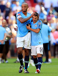 Manchester City's Vincent Kompany and Brahim Diaz (right) after the Community Shield match at Wembley Stadium, London.