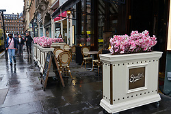 Glasgow,Scotland, UK. 2 November 2020. As Scotland enters new Coronavirus lockdown regulations the central belt and Glasgow are placed in Level 3 . Members of the public are seen out on the streets of central Glasgow for shopping and work. Pictured; Empty outdoor seating area decorated with flowers at Spuntini cafe.   Iain Masterton/Alamy Live News
