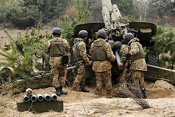 October 21, 2016 - Divychky, Ukraine - Ukrainian servicemen fire a 2A65 Msta-B howitzer during military exercises near the village of Divychky in Kyiv region, Ukraine, October 21, 2016. (Credit Image: © Maxym Marusenko/NurPhoto via ZUMA Press)