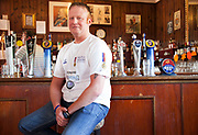 London, UK. Saturday 25th May 2013. Lee Horton (36) in the Kings Arms pub after visiting the memorial to Drummer Lee Rigby in Woolwich, London, UK. Horton, now in the security business was in a gunner in British Army Artillary, and now raising money along with many other servicemen for the charity Help the Heroes. The Kings Arms became a landmark in the area after is was bombed by the IRA in 1974.