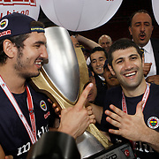 Fenerbahce players Kaya PEKER (L) and Omer ONAN (R) celebrate with the Turkish Beko Basketboll League championship trophy at the Abdi Ipekci Arena in Istanbul Turkey on Friday 17 June 2011. Fenerbahce Ulker wrapped up its fifth Turkish League championship and fourth in the last five years by holding on to edge Galatasaray CC 88-91 in Game 6 of the Turkish League finals on Friday in Istanbul. Photo by TURKPIX