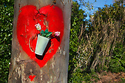 A red heart painted on a tree outside as a memorial to a roadide death in Narbonne, France.