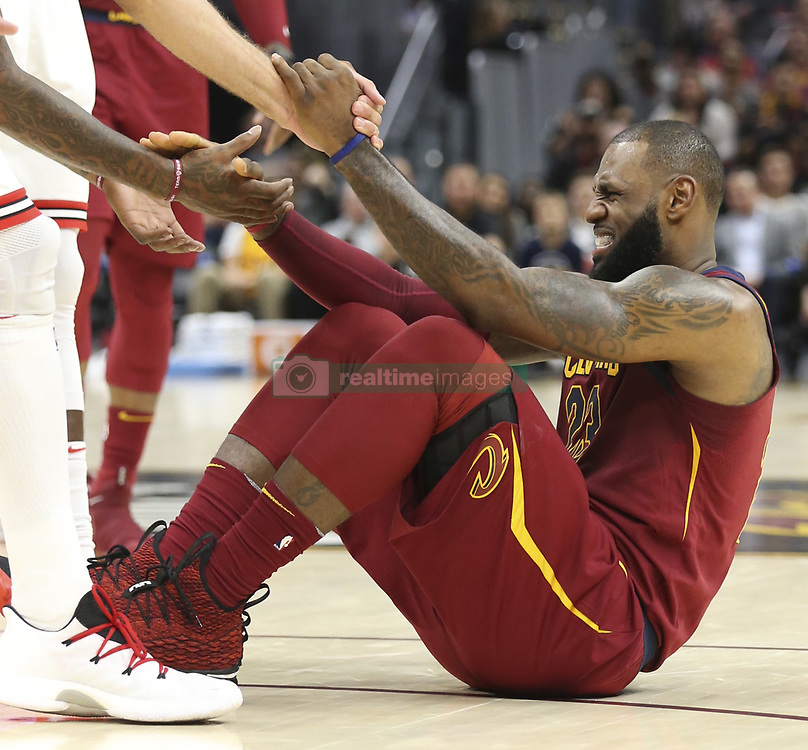 October 24, 2017 - Cleveland, OH, USA - The Cleveland Cavaliers' LeBron James is helped up after an apparent ankle injury during the second quarter against the Chicago Bulls on Tuesday, Oct. 24, 2017, at Quicken Loans Arena in Cleveland. (Credit Image: © Phil Masturzo/TNS via ZUMA Wire)