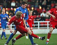 Photo: Ian Hebden.<br />Rushden & Diamonds v Grimsby Town. Coca Cola League 2. 04/03/2006.<br />Rushdens Wayne Hatswell (L) gets a shot in before Grimsbys Ciaran Toner (R).