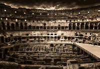"""""""Holy Cross illuminating the Colosseum - BW""""…<br /> <br /> The Colosseum, is an elliptical amphitheatre in the center of the city of Rome, the largest ever built during the Roman Empire. It is considered one of the greatest works of Roman architecture and Roman engineering in history.  Occupying a site just east of the Roman Forum, its construction started in 72 AD under the emperor Vespasian and was completed in 80 AD under Titus. Capable of seating 65,000 spectators, it was used for gladiatorial contests and public spectacles such as mock sea battles, animal hunts, executions, re-enactments of famous battles, and dramas based on Classical mythology. The building ceased to be used for entertainment in the early medieval era. It is one of Rome's most popular tourist attractions and still has close connections with the Roman Catholic Church, as each Good Friday the Pope leads a torch lit """"Way of the Cross"""" procession that starts in the area around the Colosseum.  The Colosseum is generally regarded by Christians as a site of the martyrdom of large numbers of believers during the persecution of Christians in the Roman Empire, as evidenced by Church history and tradition.  A Cross stands exultant in the Colosseum center with a plaque stating:  """"The amphitheatre, one consecrated to triumphs, entertainments, and the impious worship of pagan gods, is now dedicated to the sufferings of the martyrs purified from impious superstitions.""""  In viewing many historical sites during my journey in Italy, seeing the iconic Colosseum for the first time…I became awestruck.   It is as grand in person as it appears in the media, and it seems to hold a very mystical aura.  Climbing the ancient steps inside, one cannot help but feel not only the suffering of its past, but the forgiveness and sacrifice of its present stature."""