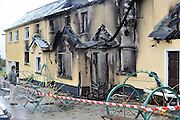 A local man stares vacantly into the burnt out shell of one of Ireland's most famous pubs, Creedon's 'Top of the Coom' on the Kerry-Cork border which claims to be the highest pub in Ireland and was extensively damaged by fire..Picture by Don MacMonagle