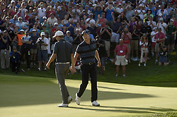 June 25, 2017 - Cromwell, CT, USA - In a show of sportsmanship Daniel Berger low-fives Jordan Spieth after Spieth holed a 61 foot bunker shot on the first play hole during the final round of the 2017 Travelers Championship ProAm at TPC River Highlands Sunday, June 25, 2017 in Cromwell, Conn. (Credit Image: © John Woike/TNS via ZUMA Wire)