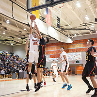 Gallup's Brad Lynch (34) takes a shot under the basket  against Espanola Valley Thursday night in Gallup.