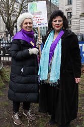 London, UK. 12th January, 2018. Coral Bower (l) and Mimi Romilly (r) pose with an anti-HS2 placard in Euston Square Gardens. Local residents and environmental campaigners are protesting against the planned felling of mature London Plane, Red Oak, Common Whitebeam, Common Lime and Wild Service trees in Euston Square Gardens to make way for temporary sites for construction vehicles and a displaced taxi rank as part of preparations for the HS2 high-speed rail line.