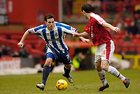 Photo: Leigh Quinnell.<br /> Bristol City v Huddersfield Town. Coca Cola League 1. 10/02/2007. Huddersfields Andy Holdsworth looks for a way past Bristol Citys  Jamie McAllister.