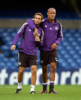 Photo: Daniel Hambury.<br />Anderlecht Training and Press Conference.<br />12/09/2005.<br />Anderlecht's Vincent Kompany (R) and Anthony Vanden Borre share a joke during training.