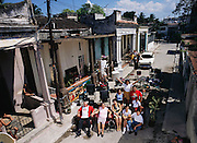 From coverage of revisit to Material World Project family in Cuba, 2001. The Costa family, with whatever new possessions they have acquired since the shooting of the photograph of the family with all of its possessions for the 1994 book Material World: A Global Family Portrait.