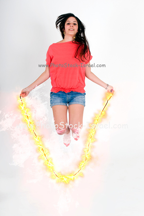 Digitally enhanced image of a female teen Skips Rope with a flaming rope