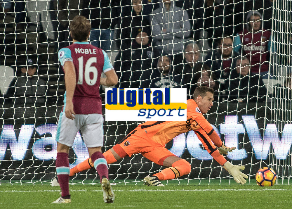 Football - 2016 / 2017 Premier League - West Ham United vs. Stoke City<br /> <br /> Adrian of West Ham gets down low to save at The London Stadium.<br /> <br /> COLORSPORT/DANIEL BEARHAM