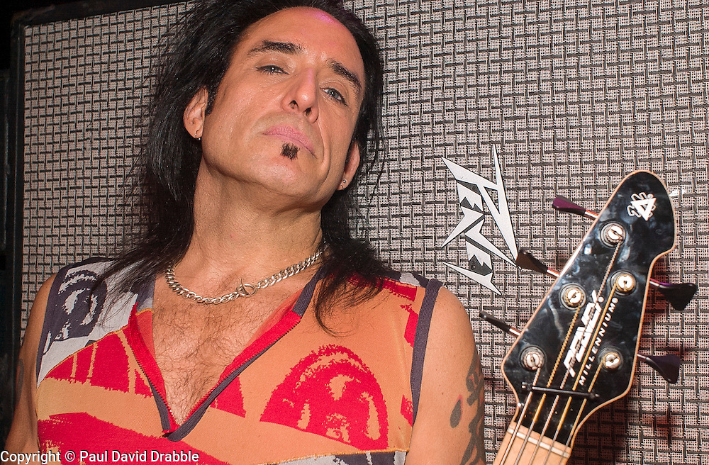 Marco Mendoza - Bass Guitarist with Whitesnake backstage before the  Monsters of Rock show at Hallam FM Arena Sheffield <br /> Marco Mendoza (born May 3, 1963) is an American rock musician. He has played bass guitarist with the likes of Thin Lizzy, Whitesnake and The Dead Daisys<br /> 21 May 2003<br /> <br /> Image Copyright Paul David Drabble<br /> <br /> Image Copyright Paul David Drabble<br /> <br /> 18th May 2003