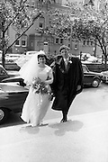An unusual sight at UCD ( Earlsfort Terrace) as groom John Quirke, Straffan, Co Kildare, arrives with his bride of 45 minutes, Mary Claire Harney, Stapleton Place, Dundalk, to receive his B.E. on Conferring Day. .14.07.1964