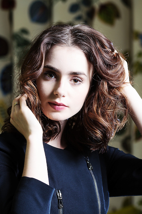 Actress & daughter of Phil Collins Lily Collins poses for portraits at The Soho Hotel in London on June 3rd 2013.<br />  <br /> Photos By Ki Price 07940447610