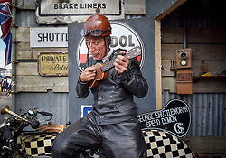 © licensed to London News Pictures. 12/09/2015<br /> Goodwood Revival Weekend, Goodwood, West Sussex. UK.<br /> The Goodwood Revival is the world's largest historic motor racing event. Competitors and enthusiasts dress in period fashions recreating the glorious days of the race circuit.<br /> Pictured. Graeme Hardy a tribute act to the George Formby  film character George Shutterworth the Speed Demon.<br /> <br /> Photo credit : Ian Whittaker/LNP