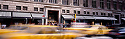 Saks 5th Avenue and yellow cabs blur by