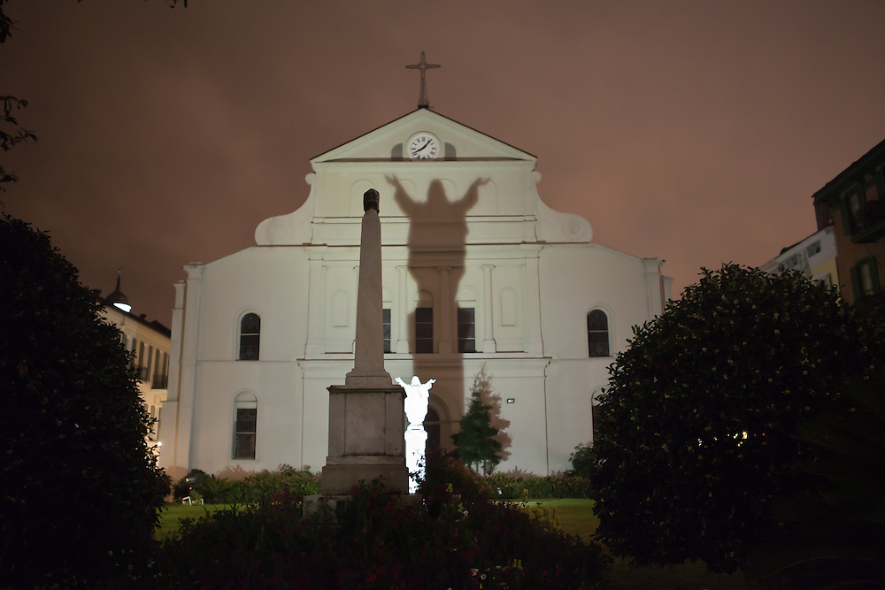 The Saint Louis Cathedral lit up at night on Mardi Gras with a shadow of Chirst cast on the church. Mardi Gras 2011 in New Orleans is expected to be have the largest attendance of all time due to the dates overlapping with college spring break. Mardi Gras also known as Carnival begins on or after Epiphany and ending on the day before Ash Wednesday.