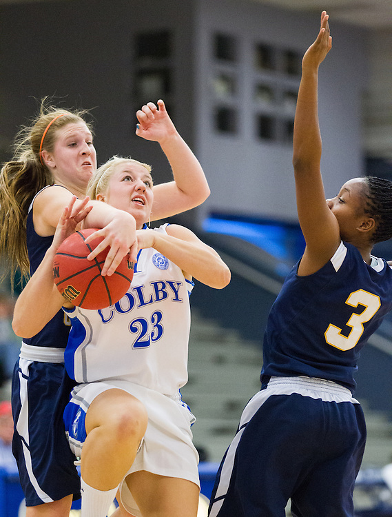 Carylanne Wolfington of Colby College drives to the hoop and has her shot blocked during a NCAA Division III college basketball game between Colby College and Fisher College at the The Whitmore-Mitchell Court at Wadsworth Gymnasium, November 27, 2012 in Waterville, ME. (Dustin Satloff/Colby College Athletics)