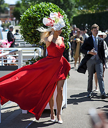 © Licensed to London News Pictures. 21/06/2018. London, UK. A racegoers poses for a photograph at Ladies Day at Royal Ascot at Ascot racecourse in Berkshire, on June 21, 2018. The 5 day showcase event, which is one of the highlights of the racing calendar, has been held at the famous Berkshire course since 1711 and tradition is a hallmark of the meeting. Top hats and tails remain compulsory in parts of the course. Photo credit: Ben Cawthra/LNP