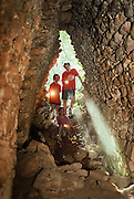 Kids exploring tombs at the Mayan ruins at Becan, Mexico. Jack and Evan Menzel and Sasha Blair.
