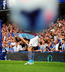 "Aston Villa's Ciaran Clark suffers a head injury  - Photo mandatory by-line: Joe Meredith/JMP - Tel: Mobile: 07966 386802 21/08/2013 - SPORT - FOOTBALL - Stamford Bridge - London - Chelsea V Aston Villa - Barclays Premier League - EDITORIAL USE ONLY. No use with unauthorised audio, video, data, fixture lists, club/league logos or ""live"" services. Online in-match use limited to 45 images, no video emulation. No use in betting, games or single club/league/player publications"