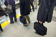 queuing for a train Tokyo Japan