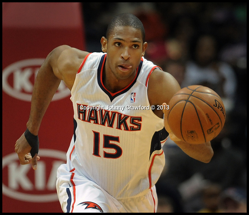 Atlanta Hawks Al Horford dribbles the basketball on the fast break.