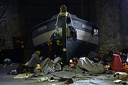 March 1, 2016 - Athens, Greece - <br /> <br /> Migrants sleep inside a warehouse at Piraeus port. Pasenger terminals and warehouses are open for migrants fleeing to northern Greek borders, where about 9000 refugees are stranded because of border controls by other Balkan and European countries. <br /> ©Exclusivepix Media
