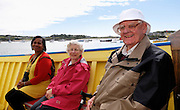 Isles of Scilly, 22 May 2009: From left, Lorna Brooks Anne and Brian Horrell on the boat to Tresco from St Mary's. Anne and Brian spent their honeymoon on the Island 50 years ago and this was the first time that they had returned. Photo by Peter Horrell / http://peterhorrell.com