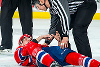 KELOWNA, BC - JANUARY 31: Jordan Chudley #5 of the Spokane Chiefs lies on the ice after a fight with Tyson Feist #25 of the Kelowna Rockets during first period  at Prospera Place on January 31, 2020 in Kelowna, Canada. (Photo by Marissa Baecker/Shoot the Breeze)