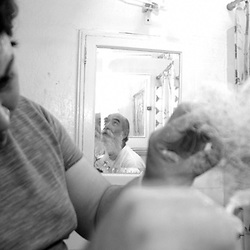 Professional Santa Claus Russell Bissonnette getting his beard whitened by hair and makeup artist Juan Nunez on Monday, Dec. 20, 2004 in Nunez's San Francisco Apartment. Nunez is the Wig Master for San Francisco's Beach Blanket Babylon. He also does work for the San Francisco Opera and Ballet. This is Bissonnette's second time working with Nunez.                               ..Photo by David Calvert<br />