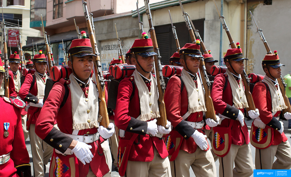 """Bolivian soldiers of the historic Colorados battalion participate in a military parade to honor national hero Eduardo Avaroa as part of """"Day of the Sea"""" celebrations. Bolivia lost its coastline 131 years ago to Chile in the """"Guerra del Pacifico"""", or War of the Pacific.  Sopocachi, La Paz, Bolivia,  March 23, 2010."""