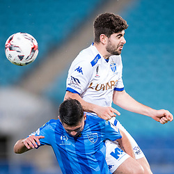 BRISBANE, AUSTRALIA - SEPTEMBER 20: Luke Pavlou of South Melbourne heads the ball over Benjamin Lyvidikos of Gold Coast City during the Westfield FFA Cup Quarter Final match between Gold Coast City and South Melbourne on September 20, 2017 in Brisbane, Australia. (Photo by Gold Coast City FC / Patrick Kearney)