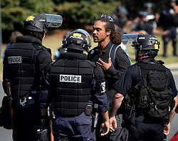 A man, center, speaks with Charlotte-Mecklenburg police officers after he was stopped outside Bank of America Stadium Sunday, September 25, 2016 in Charlotte, NC, USA. The man was arrested for items contained in his backpack. Photo by Jeff Siner/Charlotte Observer/TNS/ABACAPRESS.COM