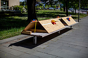 A bench prepared for social distancing on a square in Bad Homburg which is a spa city close to the Taunus mountain range.