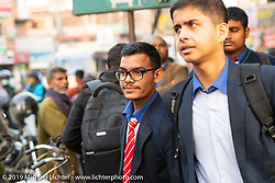 Uniformed students at the Bhaktapur Bus Depot on their way home after school in Kathmandu. Thursday, November 14, 2019. Photography ©2019 Michael Lichter.