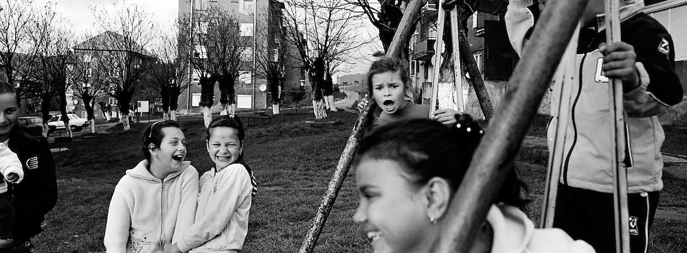 Children play in a housing estate in the heart of the small Romanian town of  Copsa Mica, Transylvania, Romania. Copsa Mica was once described as the most polluted town in Europe. May 9, 2008. Photo Tim Clayton....Copsa Mica, a small industrial town deep in Transylvania, Romania, was described during the 1990s as the most polluted town in Europe with lead levels reaching were more than 1000 times the allowable International limits and life expectancy nine years shorter than the National average...The pollution was caused entirely by two factories, Carbosin produced black for dies and tires and closed in 1993 while Sometra, a nonferrous smelter is still operational today...The pollution was so bad sheep were black, covered in soot and health officials advised against eating livestock or vegetables and drinking the water or milk...The Communist rule of Nicolae Ceausescu is blamed for the widespread environmental degradation that left industrial parts of Romania in ecological disaster. Industry was situated in a way to concentrate pollution in small areas leaving the rest of the country relatively free of pollution.Copsa Mica in particular was left an environmental disaster...The pollution caused a direct affect on human health with widespread Lung disease, Impotency, the highest infant mortality rate in Europe, Lead poisoning andbehavioral problems...Fifteen years on since the closure of Carbosin in 1993, the factory skeleton remains as part of the towns bleak landscape, Unfinished communist style housing blocks still stand in the heart of the towns housing estate. The town's inhabitants arestill trying to recover from the long lasting effects of pollution...Recent survey's found the soil contained so much lead that it was 92 times above the permitted level; the vegetation had a lead content 22 times above the permitted level. While toxins have penetrated at least one meter (three feet) into the soil leaving the entire food chain in the area conta