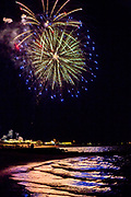 Fireworks explode over the ocean on Cape Cod, MA.